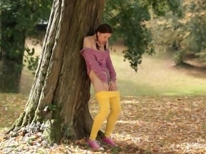 cute girl masturbates by the tree