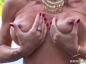sexy milf oils up her breasts