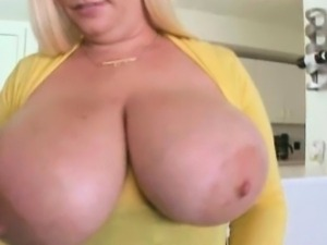 Big tit blonde does an amateur striptease