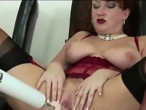 Mature matron rides mechanical dildo