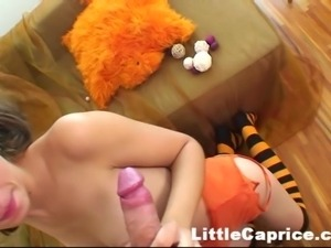 cutie in orange sucks cock