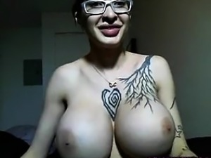 Huge tits tattoo girl with glasses teases