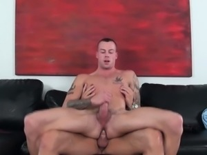 Tattooed hunk riding big cock at gaycastings