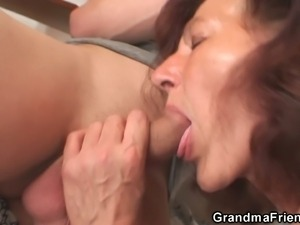 Mature brunette gets banged by two young painters