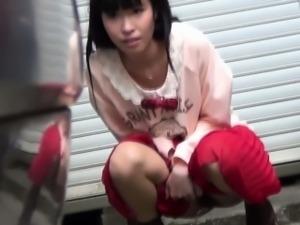 Japanes girl peeing outside