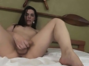 Thais Dumont tugs her cock and fingers her asshole