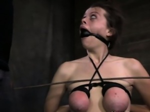Tit bonded submissive gets caned