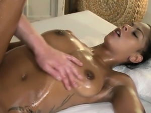 Sexy oiled brunette babe fucked by masseur