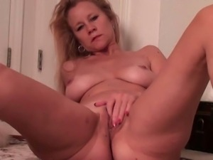 Hot brunette mom finger fucks her pussy in kitchen