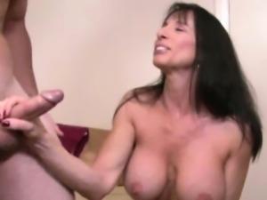 Cock tugging loving brunette jerking