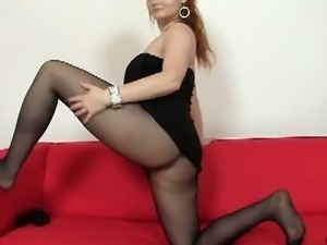 Samantha stretches a pair of nylons on her legs