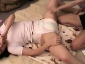 2 Beautiful schoohirls wearing diapers play together