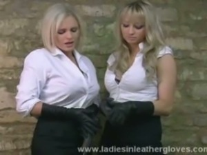 Sexy blondes in leather gloves pose and provoke