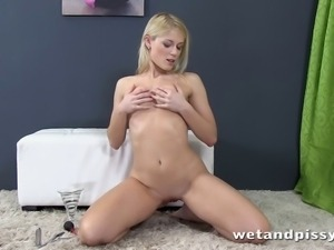 Sexy blonde spreads her big ass cheeks and pisses onto