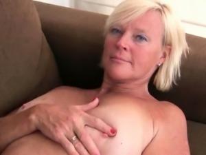Pantyhosed grandma presses her pleasure buttons