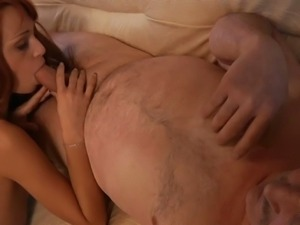 Redhead sucking out cum on her old man's cock