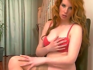 Graceful Nicole Hart takes off her sexy lingerie
