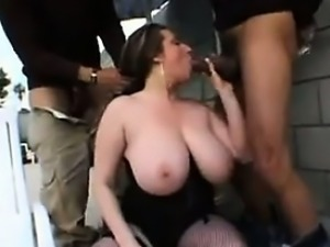 Busty Slut In An Interracial Threesome