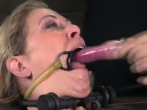 BDSM sub deepthroating toys while gagged