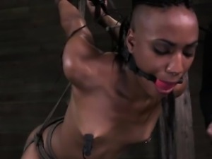 Gagged ebony sub getting punished