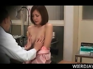 Tempting Japanese redhead taking full tits check at the docs
