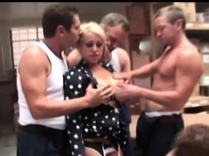 Blonde factory worker Natalie Heck checks up on her
