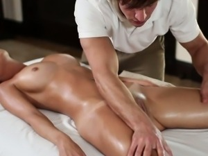 Sexy gal is getting a lusty oil rubbing from sexy hunk