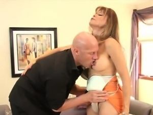 Kinky mature tranny Johanna fucking with a guy on the couch