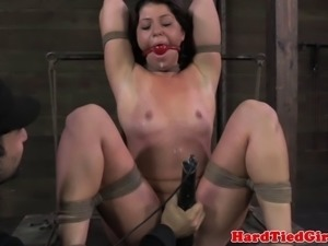 Tied up bdsm sub Mia Gold on end of dildo stick