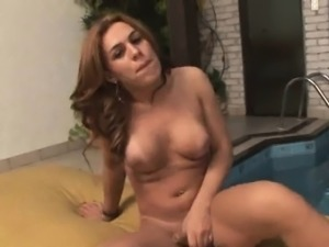 Busty shemale babe Ana Livia tugging on her cock