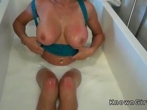 Huge boobs blonde bathing in milk and sucking