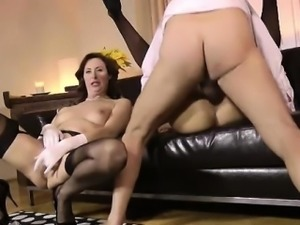 Mature British lady in stockings and blonde in threesome