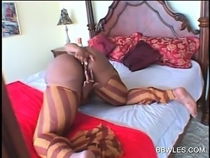 Ebony BBW lesbian rubs and spreads pink twat