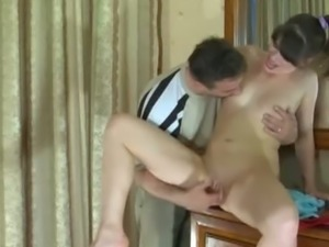 Young brunette gets banged by an older stud
