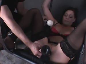 Stockinged babe submitted to machine fucking
