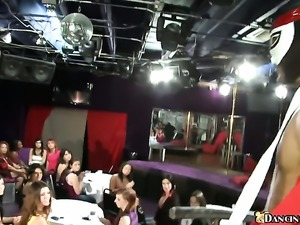 A sea of women get a stripper