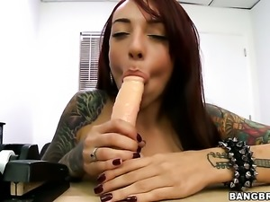 Tattooed horny chick plays with huge dildo