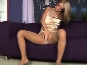 Blonde Babe In Pantyhose Using Her Dildo