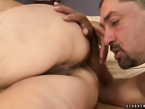 Brunette Helena May with gigantic melons is on the way to the height of...