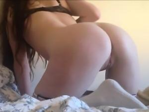 Amazingly hot brunette in black panties masturbating