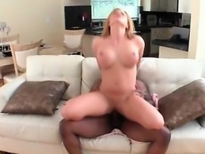 Curvy blonde humping giant black cock on sofa
