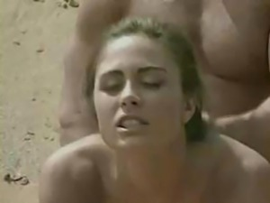 Brunette getting laid on beach