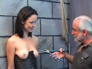 Gorgeous young girl in a bdsm corset is whipped and abused with pliers