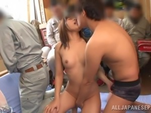 brunette japanese whore sucks many cocks at the same time