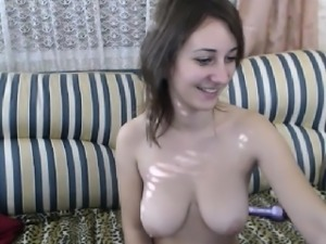 Busty camgirl chating and playing in front of a webcam