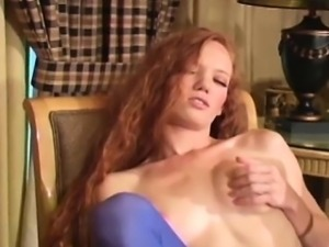 Sexy seductress exposes ass and diminutive slit in pantyhose