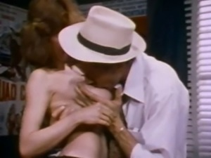 Brunette whore shows perfect tits to John Holmes