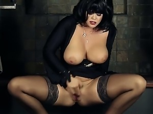 Black haired glamour babe with huge tits spreads her legs wide open to rub...
