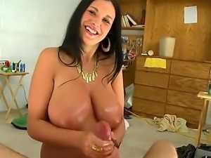 Bella Blaze is a brunette with large natural tits. She is massaging her...