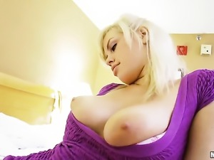 Busty amateur is on the bed